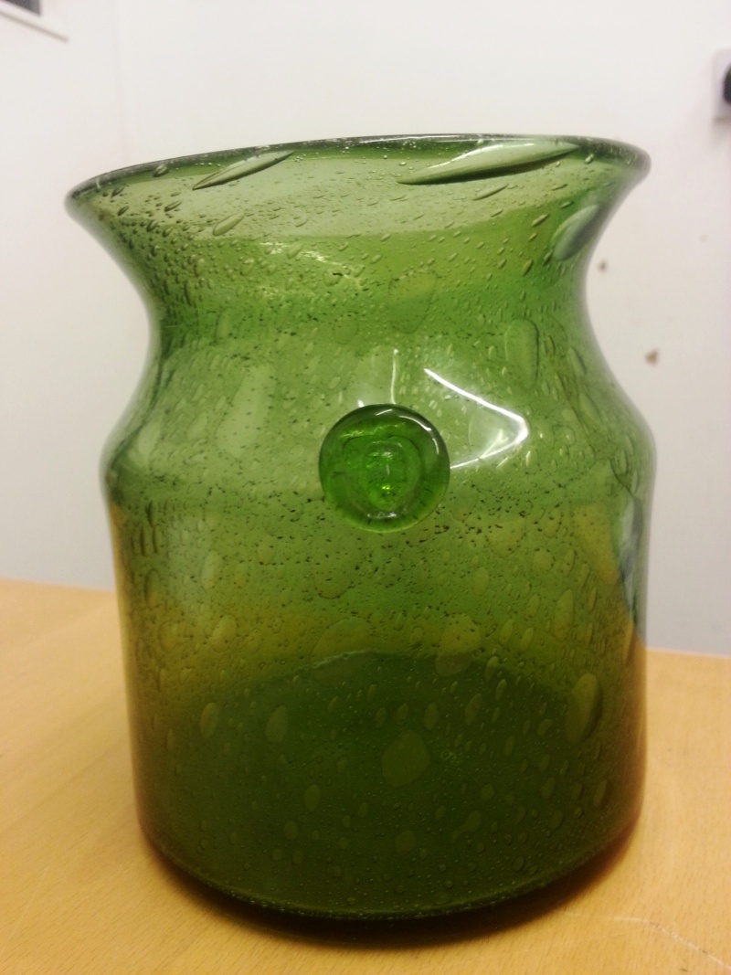 Unknown green glass jar vase with face prunt ground pontil mark on base with lots of contact wear so been around a while the pontil mark has a number engraved which is h752 180 reviewsmspy